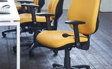 3 Yellow Operator Chairs Next To White Bench Desk