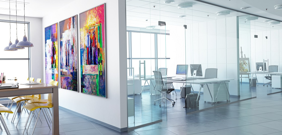 Offices with glass partition, desks, chairs, colourful artwork, tables and chairs
